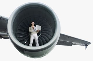 Cover Image--Woman in airplane engine